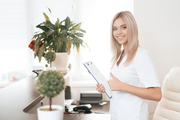 Employee of a beauty salon poses in the reception