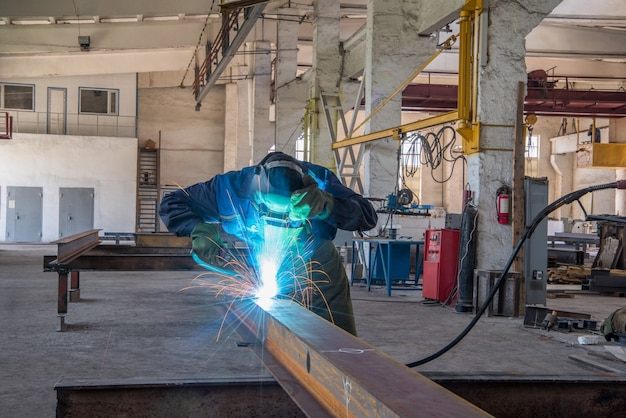 The employee conducting gas welding works