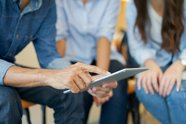 Employee holding tablet devices for explain project in meeting