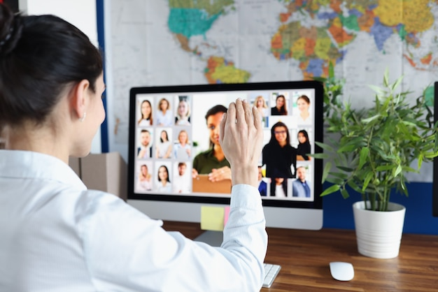 Employee is talking via video link with colleagues