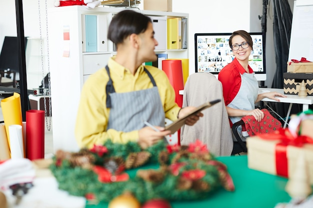 Employee making a christmas wreath