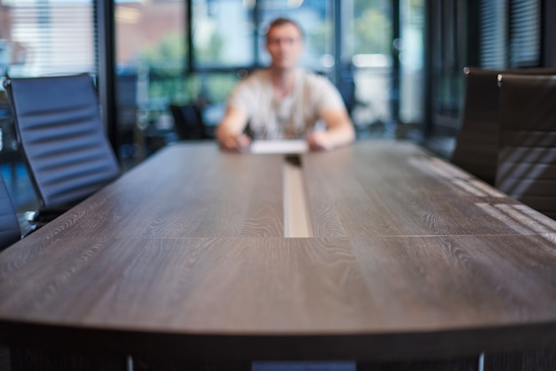 Employee in office conference room. manager at table in modern meeting room for business negotiations and business meetings.