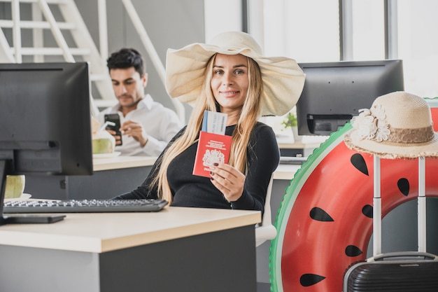 Employee in office ready to travel on summer vacation holidays.