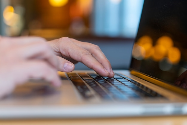Employee typing on laptop with bokeh