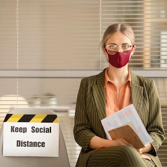 Employee wearing face mask taking a break