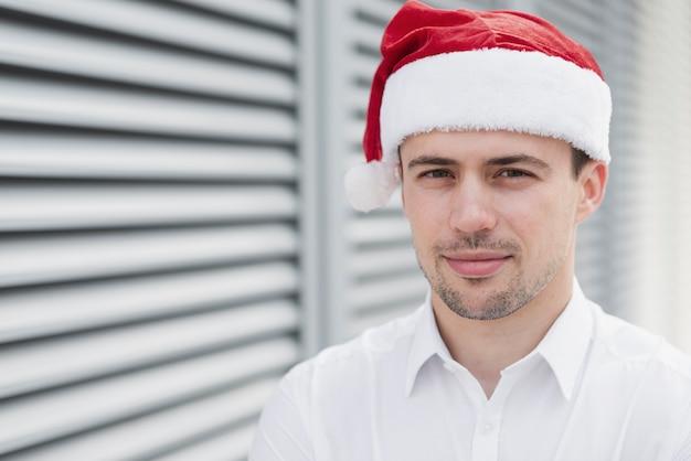 Employee wearing santa hat close up