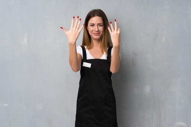 Employee woman counting eight with fingers