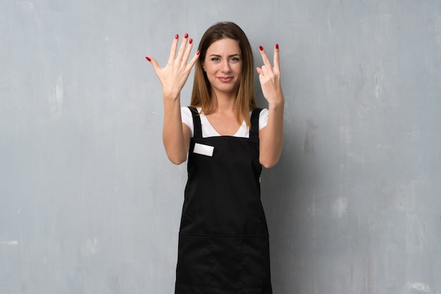 Employee woman counting seven with fingers
