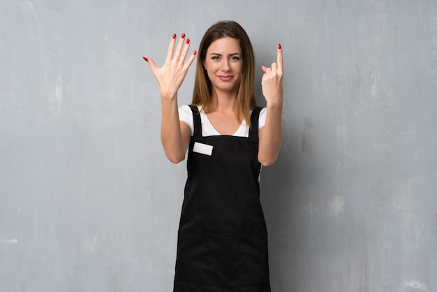 Employee woman counting six with fingers