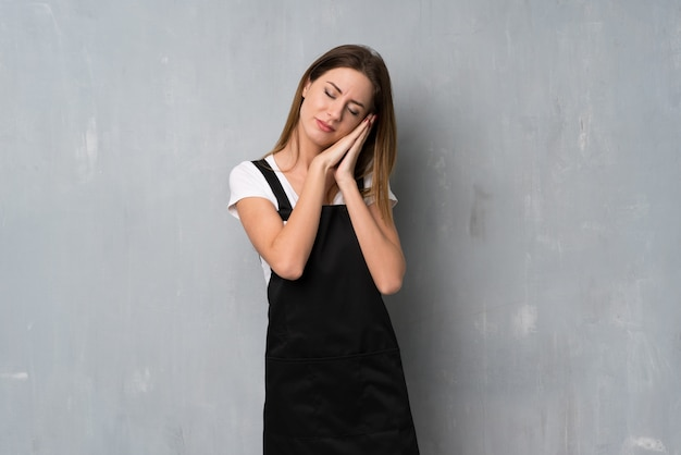 Employee woman making sleep gesture in dorable expression