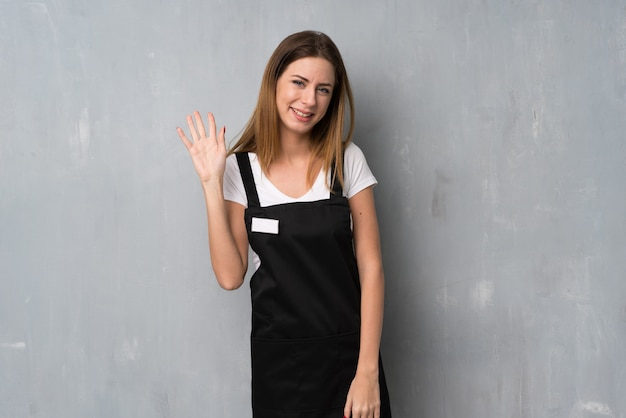 Employee woman saluting with hand with happy expression