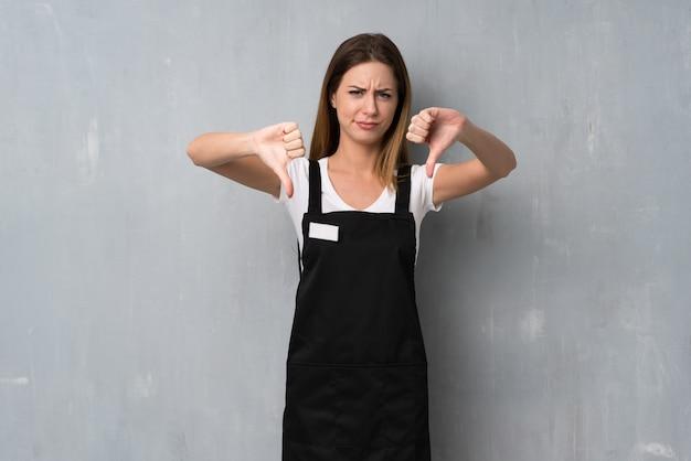 Employee woman showing thumb down