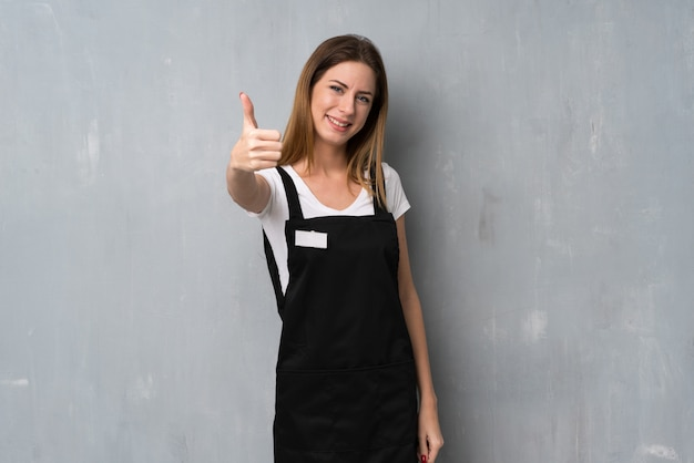 Employee woman with thumbs up because something good has happened