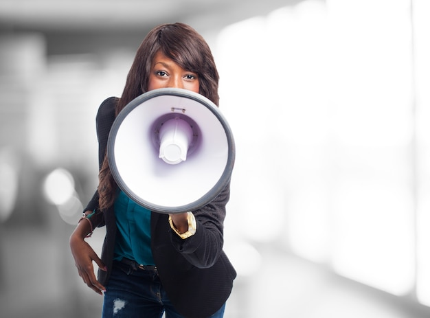 Employee working with a loudspeaker Free Photo