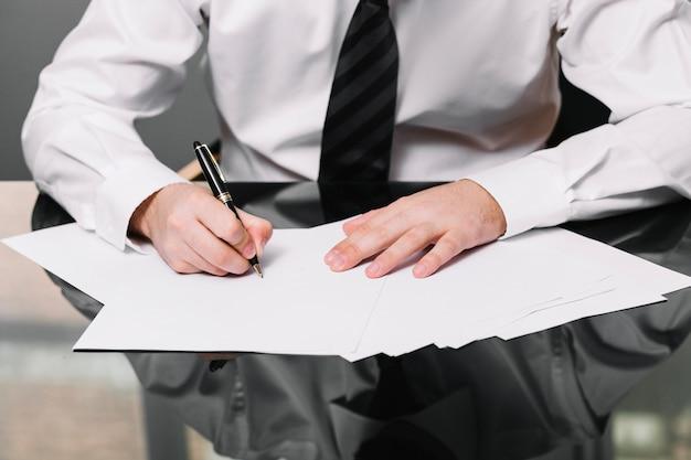 Employee writing in office