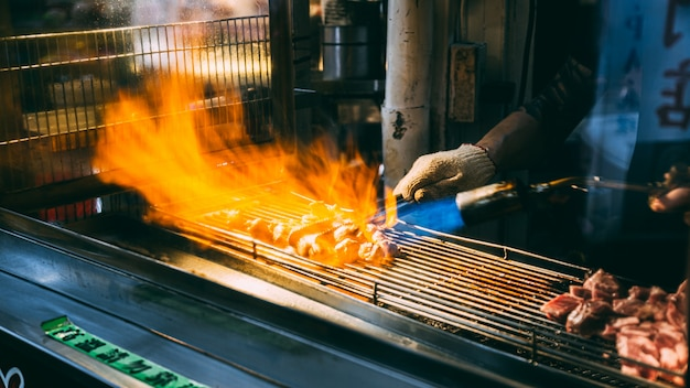 Employees are grilling meat to be sold, taipei, taiwan - 11 jun 2562.