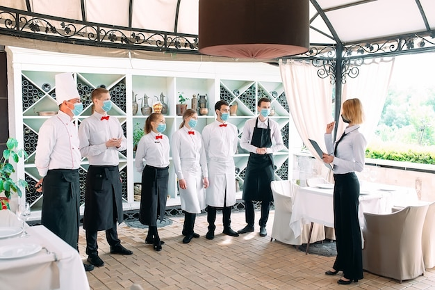 Employees of a restaurant or hotel in protective masks