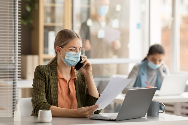 Employees wearing face masks at the office