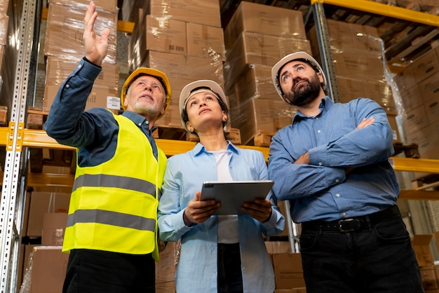 Employees with helmet working in warehouse