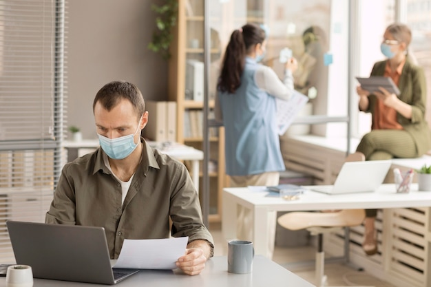 Employees working with face masks