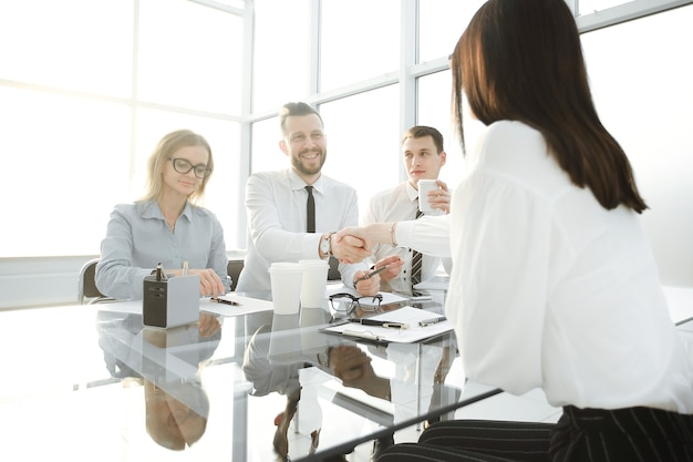 Employer shakes hands with the candidate for the vacant position . the concept for the business casting
