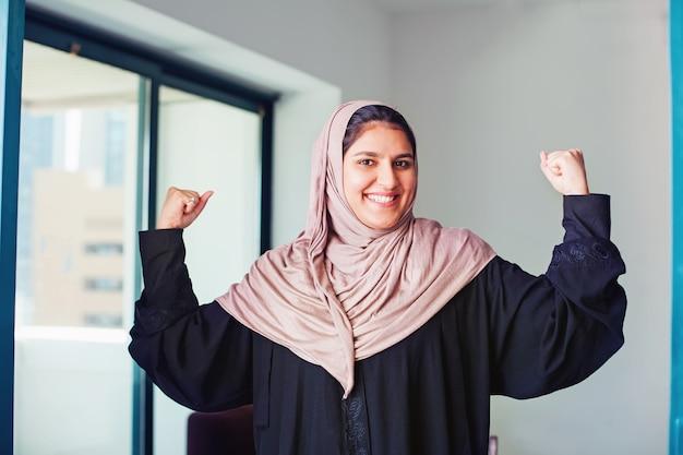 Empowered muslim womanwearing abaya