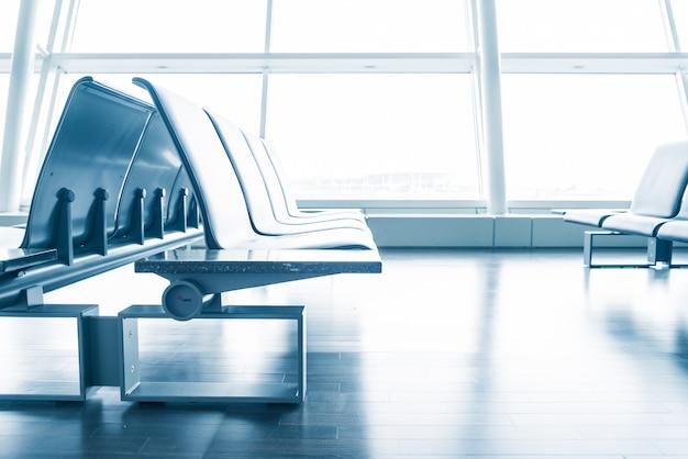 Empty airplane indoors seating nobody