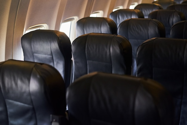 Empty airplane passenger seats in airplane