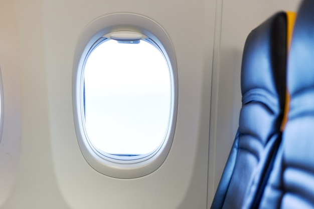 Empty airplane. passengers free airplane, cancelled flight. free window seat. cancelled flight, no travel, stop airline for prevention coronavirus pandemic. covid 19 virus outbreak quarantine