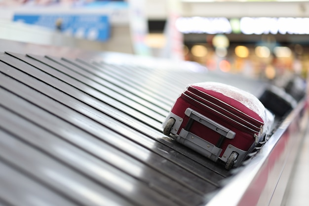 Empty airport and luggage on tape airport baggage claim concept