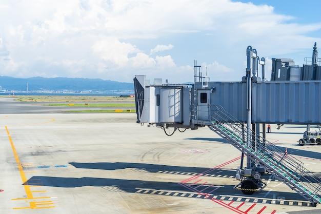 Empty airport passanger bridge without plane