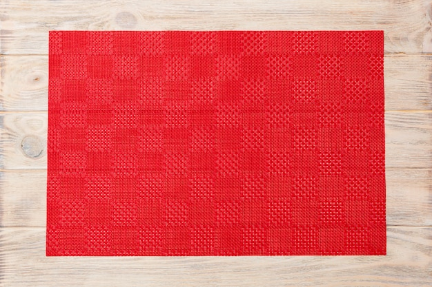 Empty asian food background. red tablecloth, napkin on wooden background top view with copy space flat lay