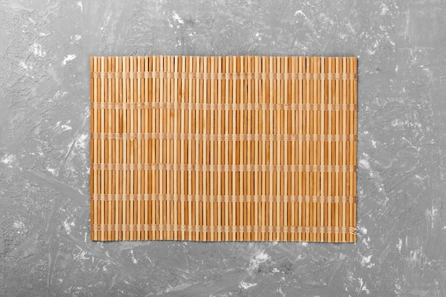 Empty asian food . brown bamboo mat on wooden background top view with copyspace flat lay
