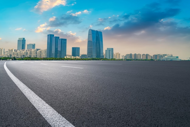 Empty asphalt road along modern commercial buildings in china,s cities