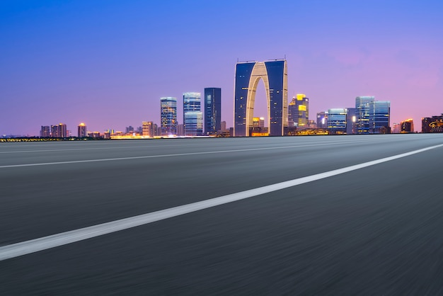 Empty asphalt road along modern commercial buildings in china's cities