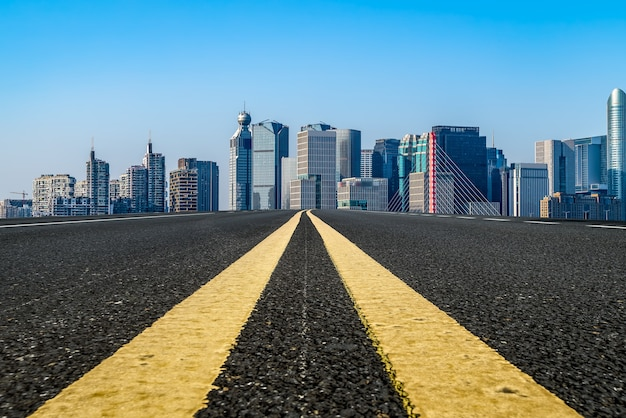 Empty asphalt road and city skyline and building landscape, china.