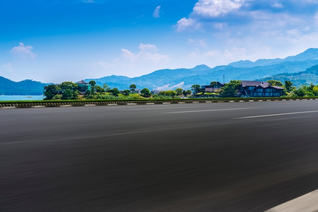Empty asphalt road and natural landscape under the blue sky