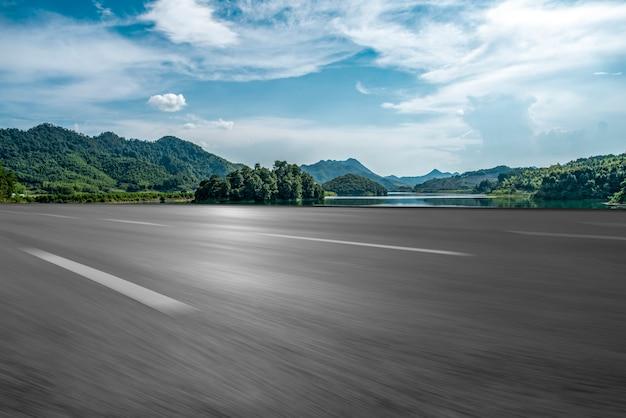 Empty asphalt road and natural landscape under the blue sky