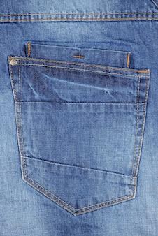 Empty back blue jeans pocket close up