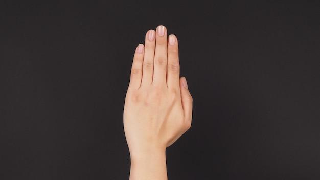 Empty back hand on black background.