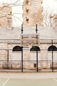 Empty basketball court in city
