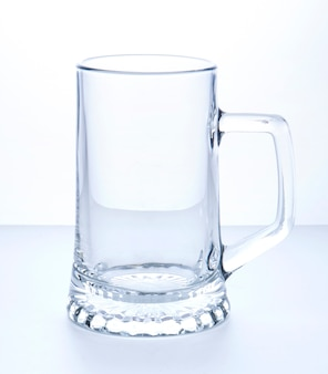 Empty beer mug on a white surface