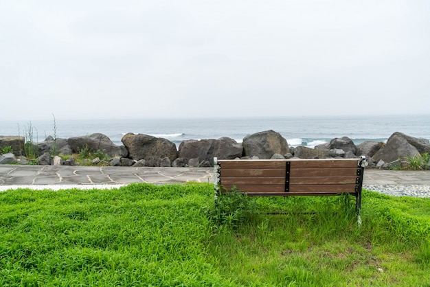 Empty bench with sea background