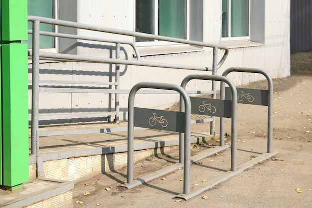 Empty bicycle parking near store with slope ramp for moving people with disabilities