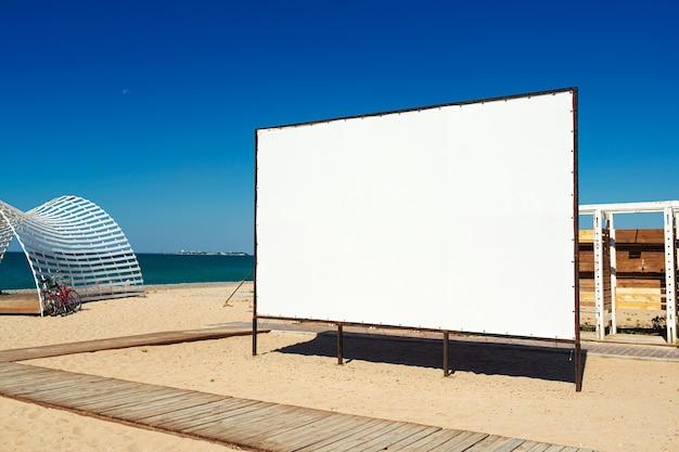 Empty big blank billboard on the beach