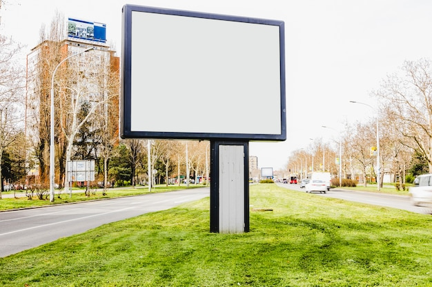 An empty billboard in the middle of city road