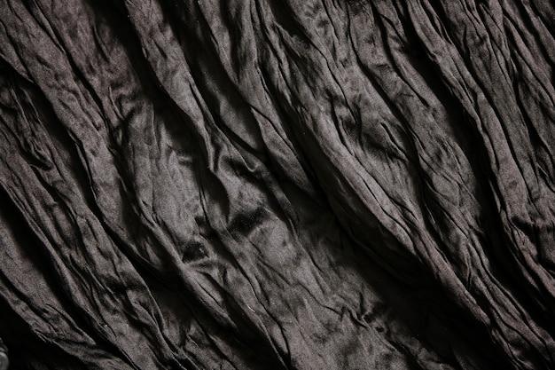 Пустой черный фон с текстурой морщин