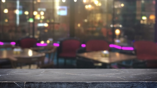 Empty black mable stone table top on abstract blurred restaurant and nightclub lights