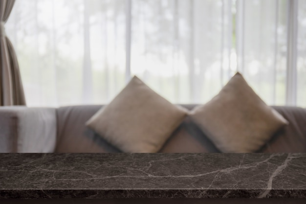 Empty black marble stone table top and blurred home interior with curtain window