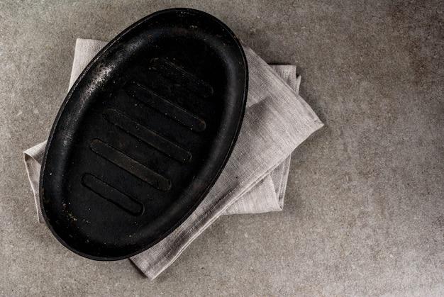 Empty black pan on tablecloth